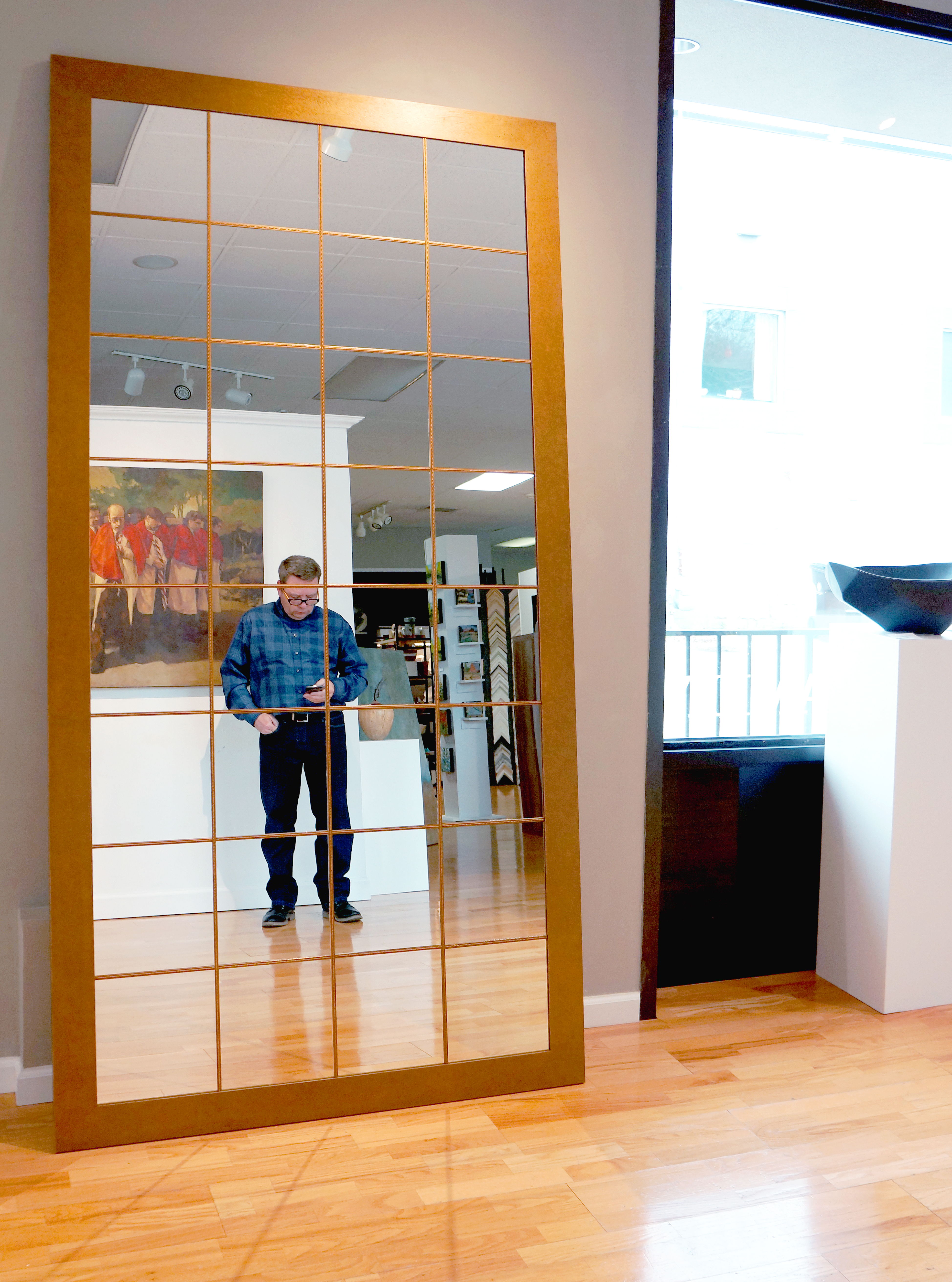 Custom paneled mirror